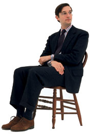Jesse Sheilower sitting in a chair
